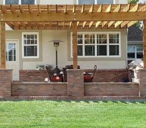 backyard lawn landscaping and brick patio